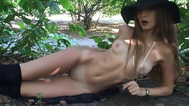 Beautiful girl loves fingering in public woods
