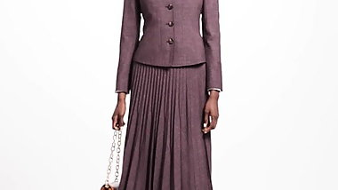 LADY WEARING NICE PLEATED SKIRT SUIT