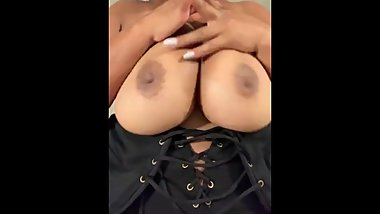 Thick black ebony mixed girl massaging huge natural tits with oil