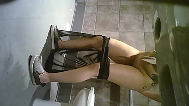 Shaved Tattoo Chick on the Toilet