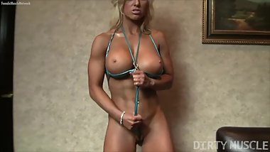 Blonde muscle barbie poses in a string bikini and gets wet