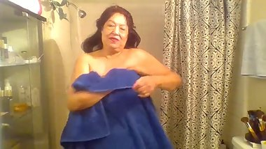 Mature woman taking a shower