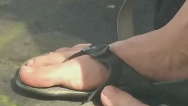 Candid Student girl in the flipflop whit natural toes face