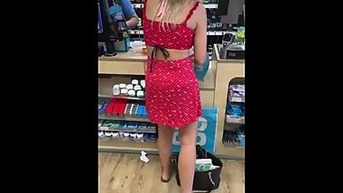 Sexy blonde with freshly pedicured toes in supermarket