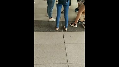 asian girl candid flats and little shoeplay in train station