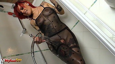 Tattoed redhead in pantyhose masturbates in the shower