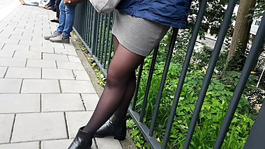 Girl in black pantyhose waiting for train