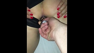 Sticking butt plug up slut-wife's ass