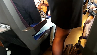 Student in black pantyhose standing in train