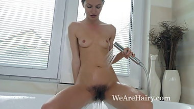 Efina strips naked before enjoying a nice shower