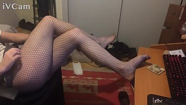 Teasing with fishnets and sexy college mini skirt
