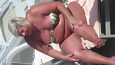 BBW GILF in bikini nip-slip while tanning on the beach