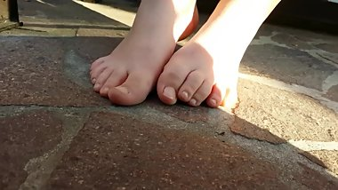 TEEN WITHOUT SHOES AND SOCKS RUBBING FEET