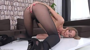 Hot babe teasing in black pantyhose