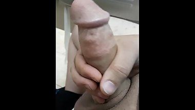 Masturbating at work in the bathroom.