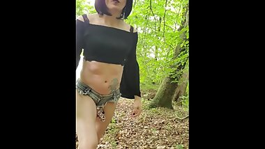 Sissy plugged and caged walking in the woods