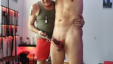 Playing with a slave´s cock