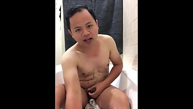Young exposed Asian sub drinking piss and cumming