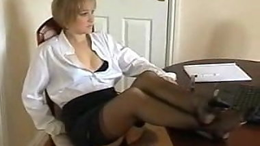 Blonde British GF teases in black stockings and suspenders