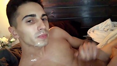19 year old boy squirts his cum into his mouth and face.