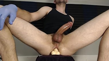 Hot guy edging while riding a dildo and cumming hard