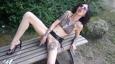 Lucy Ravenblood smoking and diloing her pussy in a public park