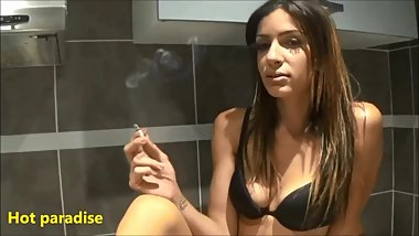 My slave kisses and licks my feet then one of my legs while I smoke