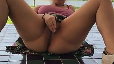 Nancy Miami looking around as she's masturbating in the open