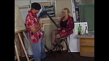 German blonde MILF in stockings is the muse to a lazy artist