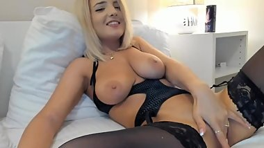 Sexy blonde smoking while fingering