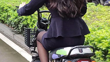 The sales lady in black pantyhose hurried to work