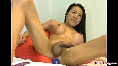 Sexy Long Legged Asian Girl Strokes Her Cock & Cums